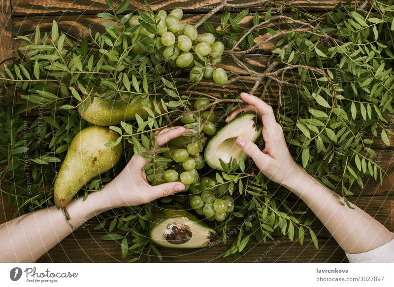 woman's hands holding grapes, pears and avocados Agriculture Avocado Branch Farm Woman flat lay Food Healthy Eating Dish Fresh Fruit Garden Bunch of grapes