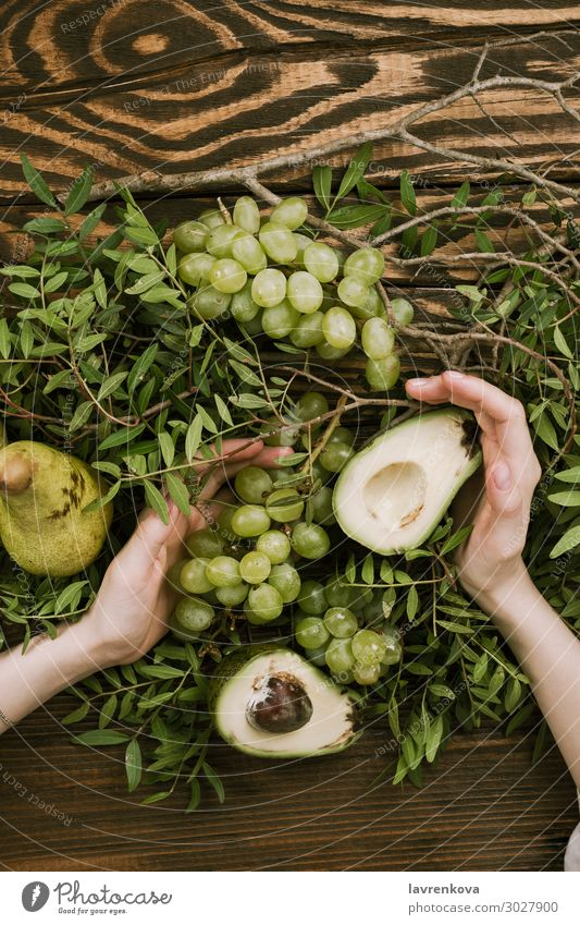 woman's hands holding grapes, pears and avocados Agriculture Avocado Branch Farm Woman flat lay Food Healthy Eating Food photograph Fresh Fruit Garden