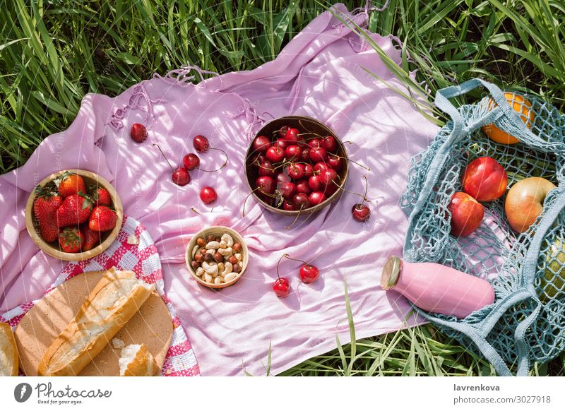 Zero waste summer picnic Sustainability Picnic Apple Baguette Berries Bottle Bread Bright Cherry Food Healthy Eating Dish Food photograph Fresh Grass Hat Hot