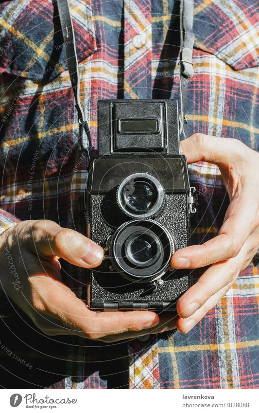 Closeup of man's hands holding vintage camera Retro Capture Exterior shot Photography shoot Old plaid shirt Faceless Lens Photographer Film Hold Hand Man Camera