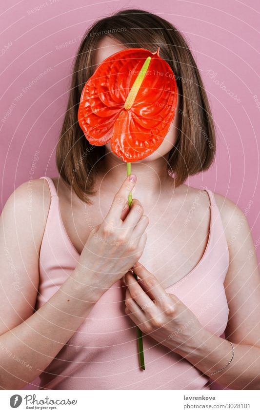 Woman's holding red peace lilly bloom Red Hand Flower Eroticism Love Style Fashion Pink Body Fingers Beauty Photography Lily Spa Faceless Spatiphyllum