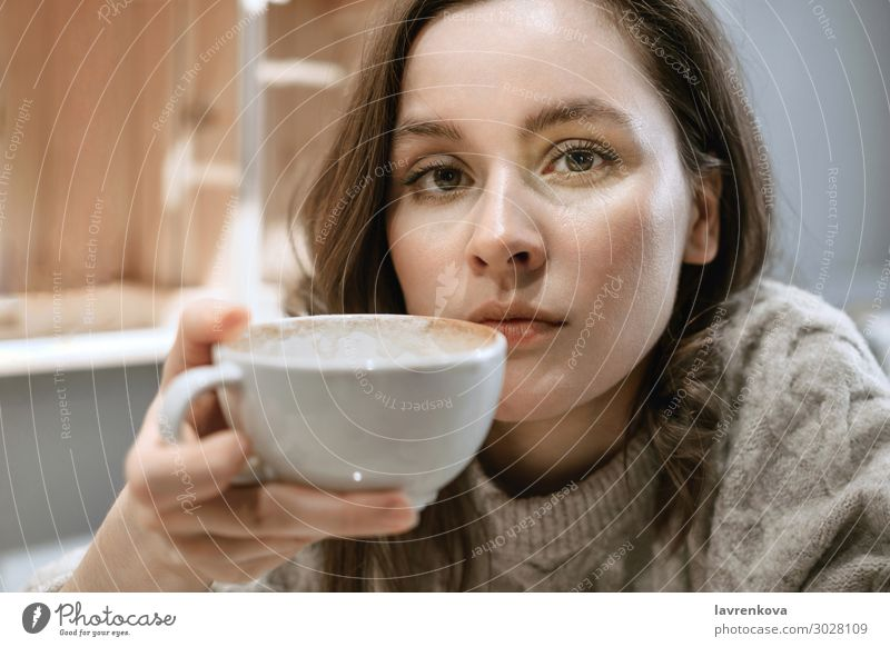 Young adult white woman with big cup of latte Restaurant Sweater Seasons Beverage Hot hygge Hold Tea Face Cup Mug Lifestyle Woman Young woman