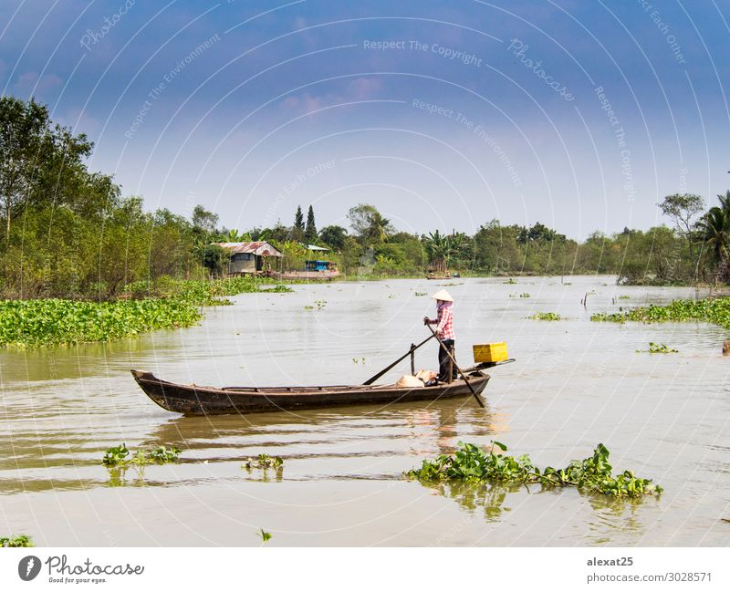 Boat sailing through the mekong delta Beautiful Vacation & Travel House (Residential Structure) Nature River Village Watercraft Green Asia asian colorful East