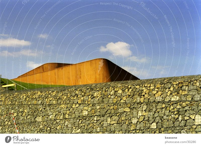 Sky Blue Clouds Wall (building) Mountain Stone Metal Lawn Rust