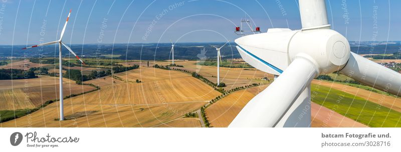 Panorama of a wind farm and close-up view Technology Energy industry Renewable energy Wind energy plant Environment Landscape Sky Summer Autumn