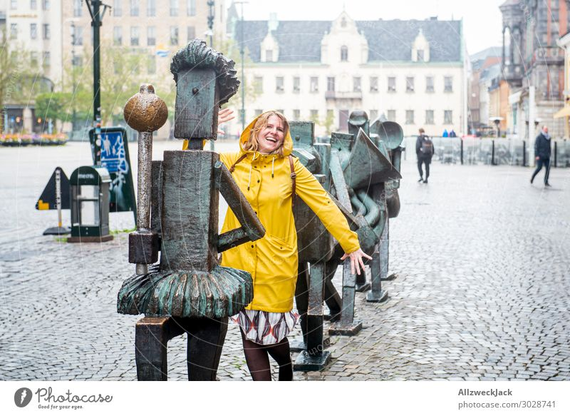 young woman in yellow rain jacket marches with Sweden Malmo 1 Person Central perspective Downtown Old town Bad weather Rain Young woman Joy Playing Dance March