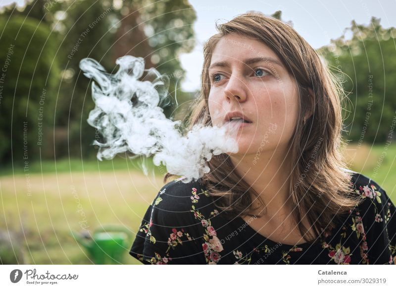 exhale Smoking Intoxicant Feminine Young woman Youth (Young adults) 1 Human being Nature Plant Summer tree Grass bushes Garden Watering can Cigarette smoke