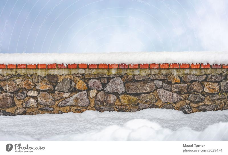 Stone wall covered by snow with a sky background Winter Snow Nature Landscape Sky Clouds Weather Rock Town Castle Architecture Old Natural Retro Blue White