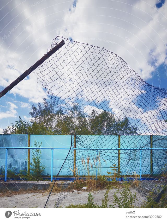 Wide-meshed Sky Clouds Tree Gate Fence Wire netting fence metal gate Concrete Metal Old Decline Past Transience Destruction Territory lost places Going Deserted