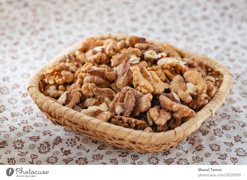 Fresh peeled walnuts in a rattan basket Fruit Dessert Nutrition Eating Breakfast Vegetarian diet Diet Table Nature Flower Wood Delicious Natural Brown Yellow