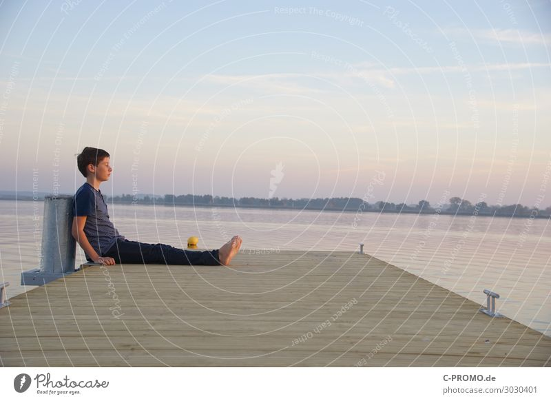 Chill out at the lake Human being Masculine Boy (child) 1 13 - 18 years Youth (Young adults) Water Sky Sunrise Sunset Sunlight Beach Lake T-shirt Pants Brunette