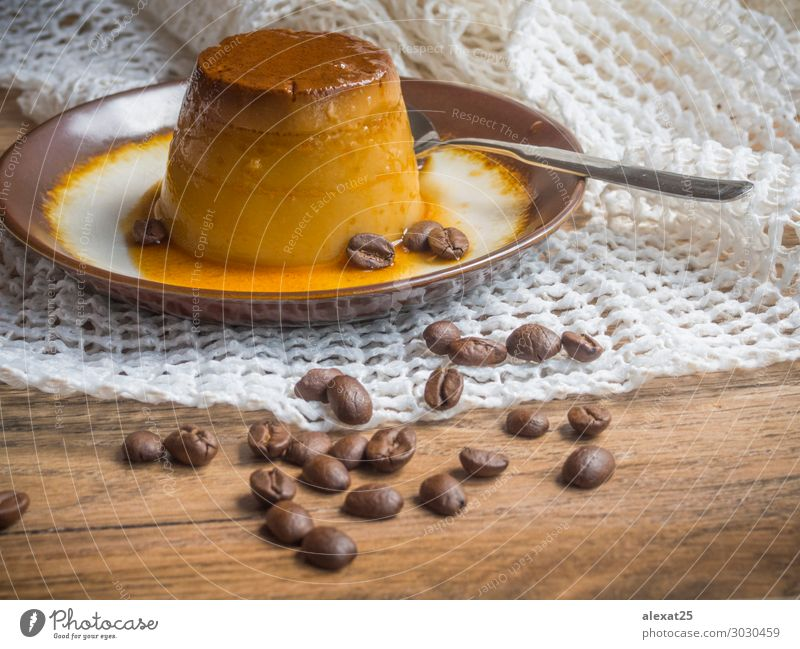 Coffee flan in a plate on wood background Dessert Plate Delicious White Tradition Caramel cream Creamy Cooking custard food Gourmet Horizontal Meal milk