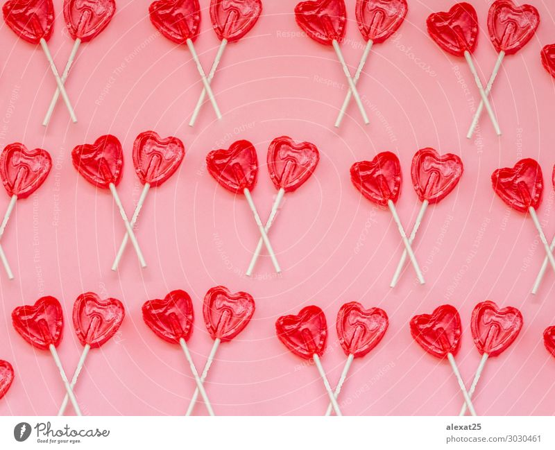 Two red heart lollipop pattern on pink background Dessert Joy Valentine's Day Art Heart Love Bright Delicious Red White Romance Colour candy colorful