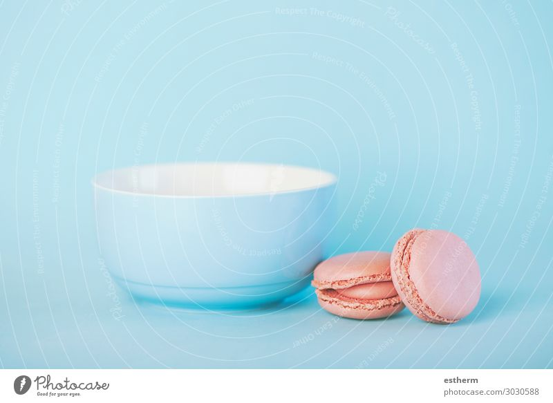Raspberry pastel pink macarons next to a blue bowl Food Dairy Products Cake Dessert Candy Nutrition Eating Breakfast Lunch Hot drink Milk Coffee Bowl Lifestyle