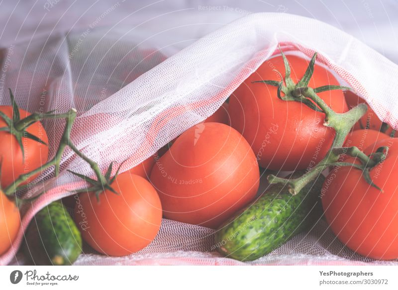 Fresh tomatoes and cucumbers in an eco bag close up. Healthy Eating Colour Green White Red Food Lifestyle Environment Modern Vegetable Diet Vegan diet Tomato