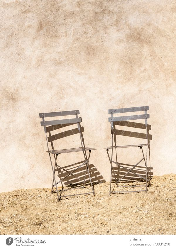Two chairs Chair house wall bailer Rendered facade metal chair Shadow Shadow play Wall (building) Facade Wall (barrier) Structures and shapes Copy Space top