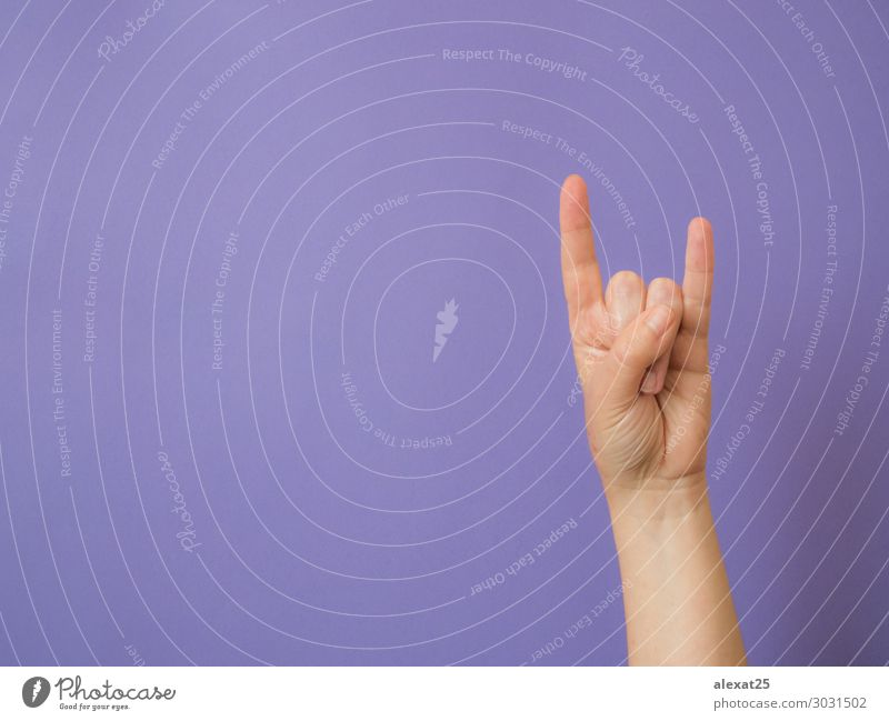 "Female hand shows sign ""devil"" on purple background Music Human being Arm Hand Fingers Rock Metal White Conceptual design conceptual Copy Space Devil Evil"