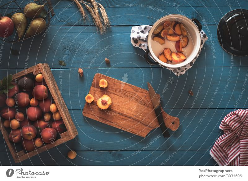 Fresh fruits and the preparation for peaches jam Blue Red Healthy Yellow Orange Fruit Table Delicious Kitchen Tradition Harvest Mature Knives Rustic Crate