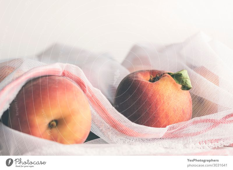 Fresh ripe peaches in an eco-friendly reusable bag Food Fruit Diet Lifestyle Shopping Healthy Eating Environment Packaging Orange agriculture commercial