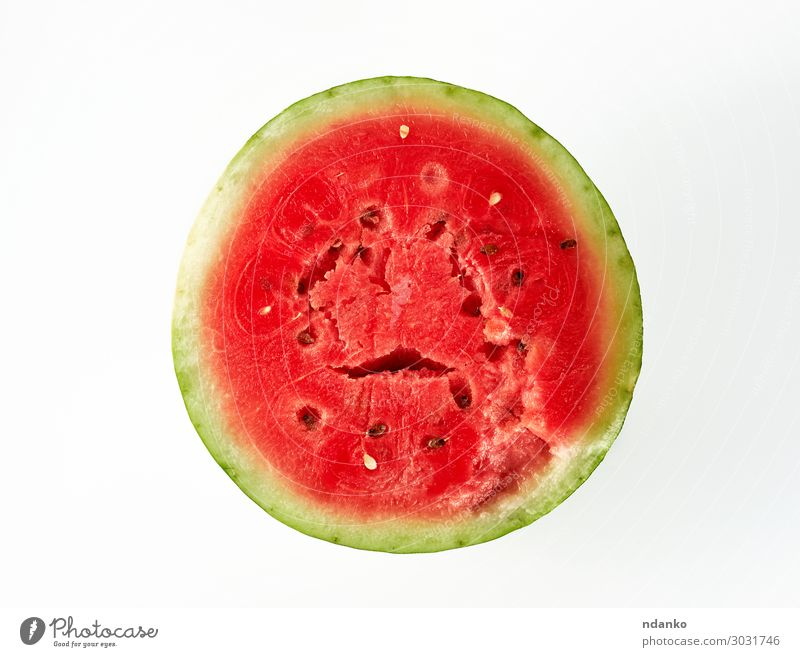 half ripe red watermelon with brown seeds Fruit Dessert Nutrition Vegetarian diet Diet Eating Fresh Delicious Natural Juicy Green Red White anove Water melon