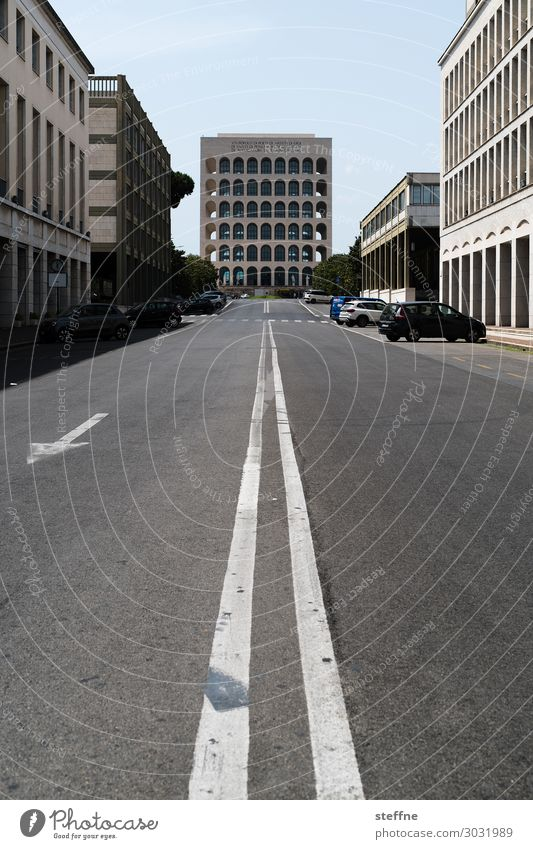 on the road | on the road again Town Facade Italy Rome World exposition Modern architecture Street Palazzo della Civiltà Italiana Transport Symmetry