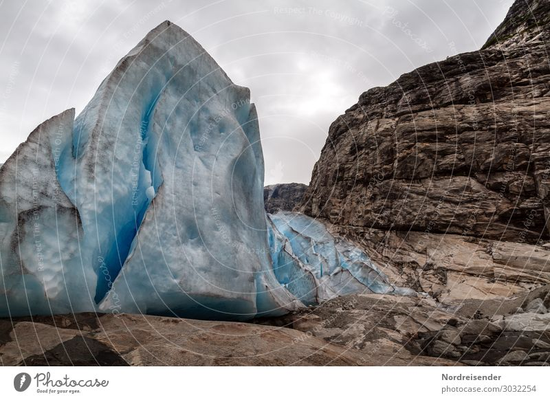 glacial ice Vacation & Travel Tourism Elements Sky Clouds Ice Frost Rock Mountain Glacier Dark Blue Brown Loneliness Uniqueness Cold Moody