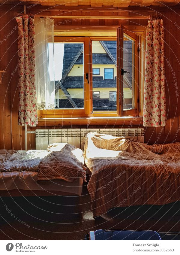 A warm moody room, wooden guesthouse, messy sheets, two beds Lifestyle Harmonious Well-being Relaxation Calm Living or residing House (Residential Structure)