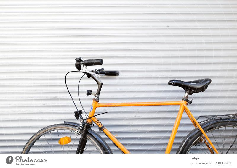 men's bicycle Deserted Disk Garage door Cycling Bicycle Metal Line Stripe Simple Yellow Black White Ajar Poised to act Parking Parking area Colour photo