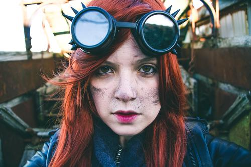 Young woman wearing steampunk style clothes Woman Face Adults Life Style Exceptional Work and employment Earth Crazy Uniqueness Industry Strong Model Brave