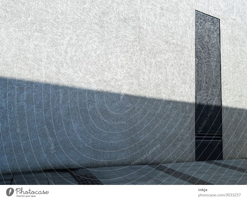 Facade, Floor, Shadow Deserted Building Architecture Wall (barrier) Wall (building) Stone Concrete Dark Bright Gray Black Bleak Modern Impersonal Colour photo