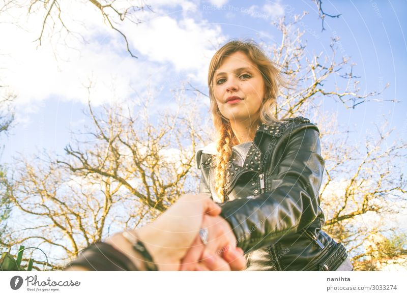 Young blonde woman holding the hand of her boyfriend Woman Human being Sky Nature Youth (Young adults) Young woman 18 - 30 years Lifestyle Adults Environment
