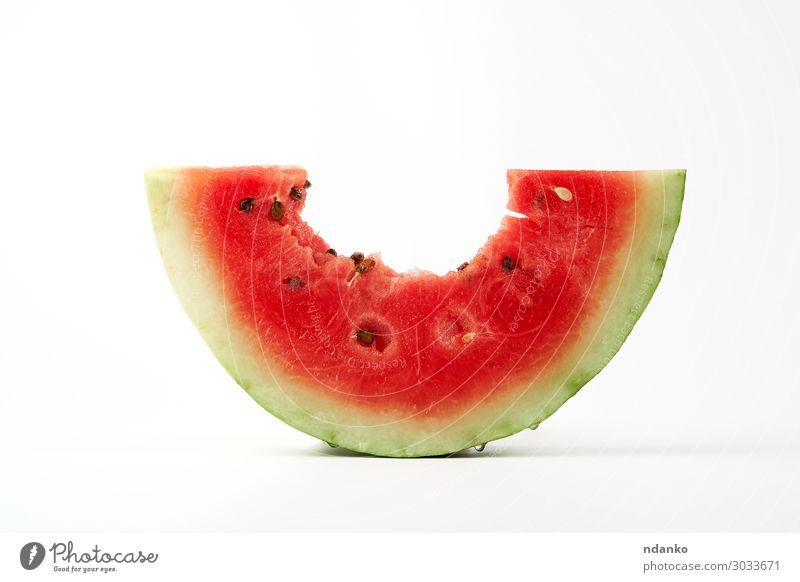 bitten off a piece of ripe red round watermelon with seeds Fruit Dessert Nutrition Vegetarian diet Diet Summer Nature Fresh Natural Juicy Green Red White