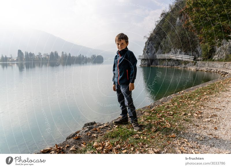 Alone at the lake Child 1 Human being 3 - 8 years Infancy Environment Nature Clouds Autumn Fog Alps Mountain Lakeside Relaxation Going Stand Hiking Wait