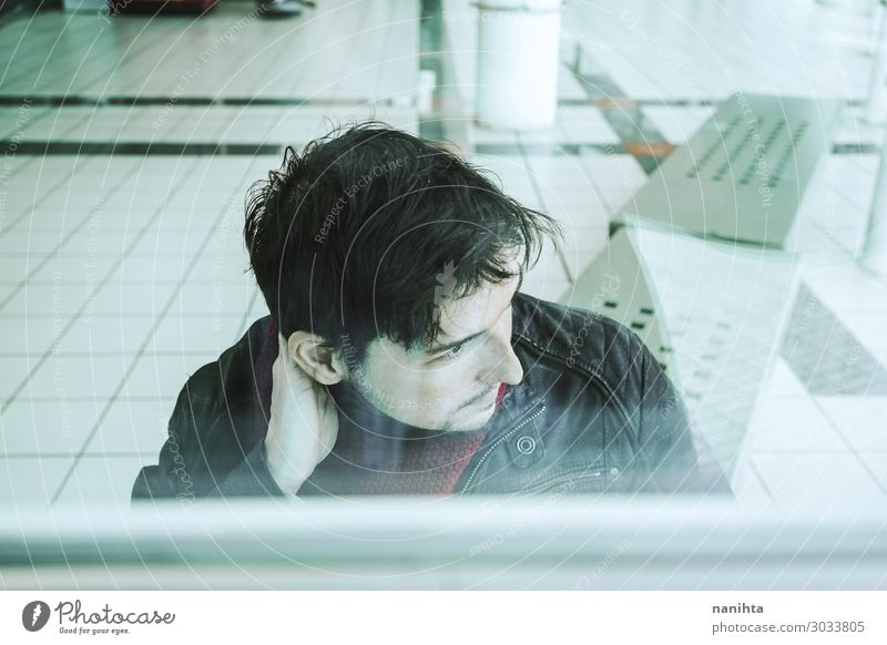 Young man looking throgh a window Human being Youth (Young adults) Man White Loneliness Winter Window Face Lifestyle Adults Style Masculine Retro Dirty Glass