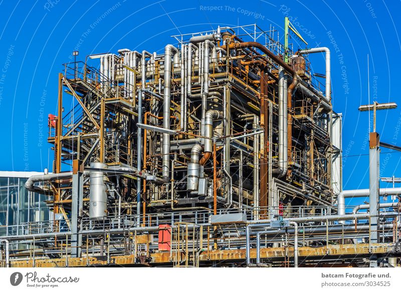 Pipes of an oil plant Chemical plant Work and employment Economy Industry Energy industry Technology Industrial plant Blue Brown Yellow Gray Red Silver White