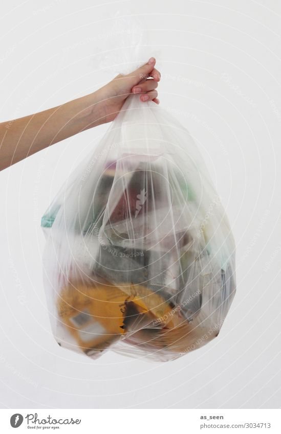 throwaway society Arm Hand Fingers Environment Climate Climate change Packaging Plastic packaging Sack Oil Trash container To hold on Authentic Yellow Gray