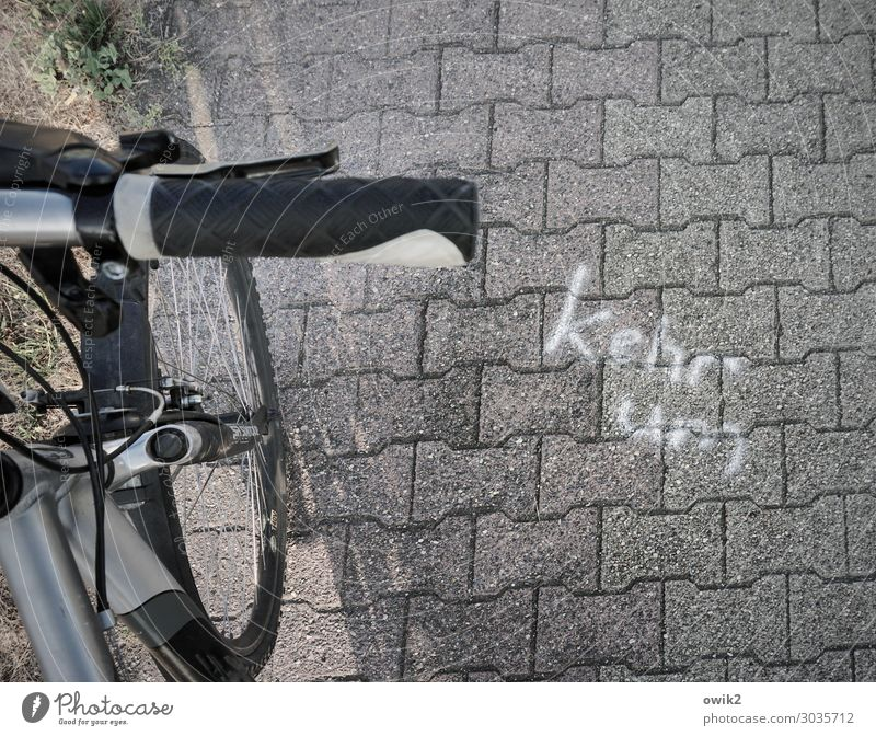 Graffiti Religion and faith Stone Metal Transport Characters Bicycle Cycling Concrete Sign Information Plastic Under Traffic infrastructure Wheel Paving stone