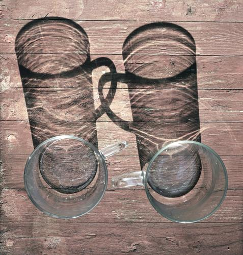 Firm friends Tea glass 2 In pairs Loyalty Together Friendship Carry handle Tabletop Wood Glass Simple Round Connectedness Colour photo Exterior shot Close-up