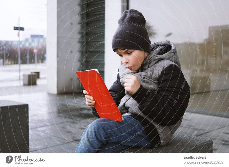 Boy with Tablet Computer Lifestyle Joy Leisure and hobbies Playing Computer games Winter Entertainment Notebook Technology Entertainment electronics Internet