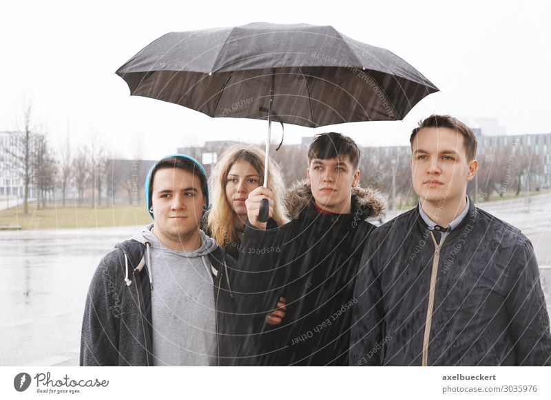 four friends under an umbrella Lifestyle Leisure and hobbies Human being Young woman Youth (Young adults) Young man Woman Adults Man Friendship 4 Group