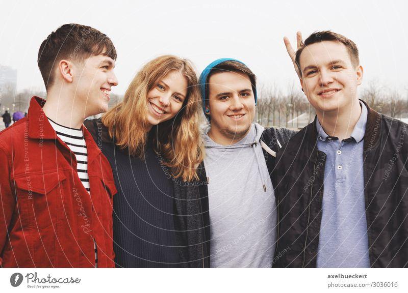 Four friends posing arm in arm Lifestyle Joy Leisure and hobbies University & College student Human being Masculine Feminine Young woman Youth (Young adults)