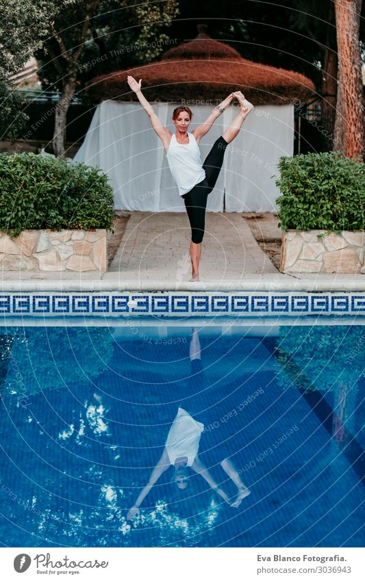 woman doing yoga by swimming pool. Yoga and mindfulness Woman Human being Sky Vacation & Travel Nature Youth (Young adults) Young woman Summer Blue Town