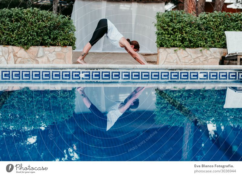 woman doing yoga by swimming pool. Yoga and mindfulness Woman Human being Sky Vacation & Travel Nature Youth (Young adults) Young woman Summer Plant Blue Town