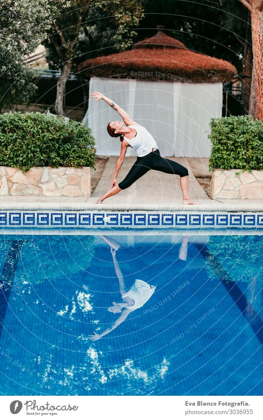 woman doing yoga by swimming pool. Yoga and mindfulness Woman Human being Vacation & Travel Nature Youth (Young adults) Young woman Summer Blue Beautiful Water