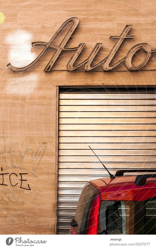Auto on the road again Facade Transport Means of transport Car Roller shutter Workshop Characters Old Mobility Parking Italy Colour photo Exterior shot Deserted
