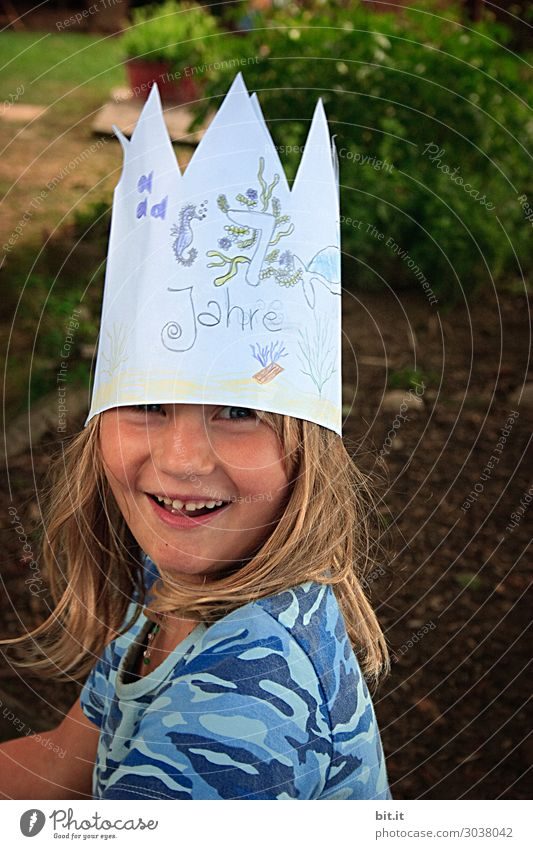 Birthday child with crown on his head, at home in the garden. Party Feasts & Celebrations Human being Feminine Child girl Family & Relations Infancy Joy luck