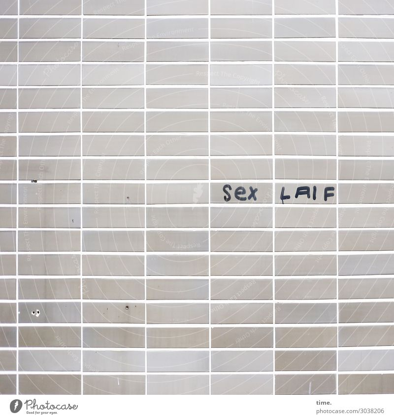 Laif is Laif Wall (barrier) Wall (building) Facade Tile Sign Characters Signs and labeling Graffiti Line Stripe Sharp-edged Funny Trashy Gloomy Gray Passion