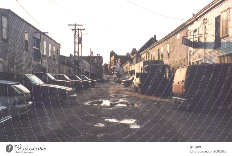 House (Residential Structure) Street Gloomy Derelict Pavement Shabby Analog Puddle High voltage power line Ghetto Housefront Unkempt Sidestreet Pothole Maine
