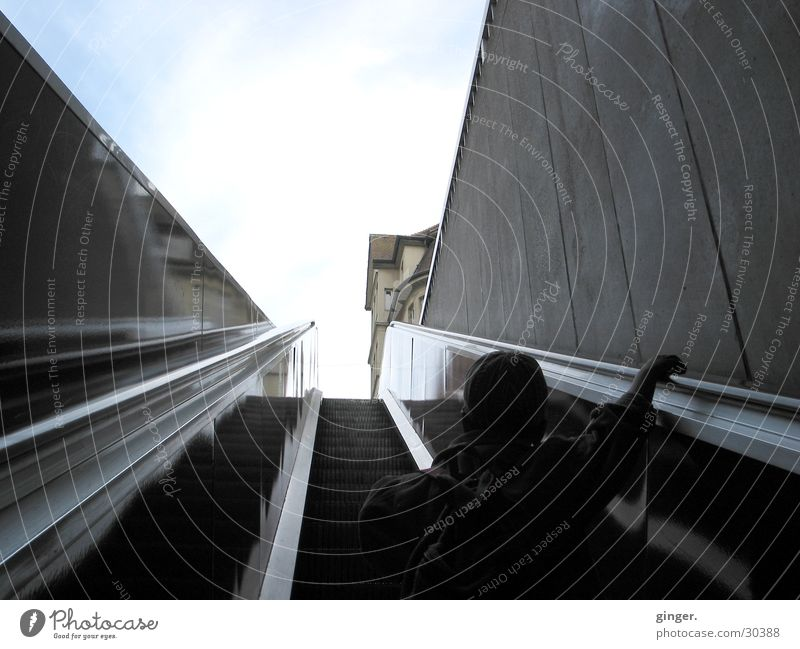 Into the light Sky Stairs Escalator Utilize Movement Driving To hold on Dark Blue Gray Black White Mobility In transit Upward Comfortable Rear view Tall Skyward