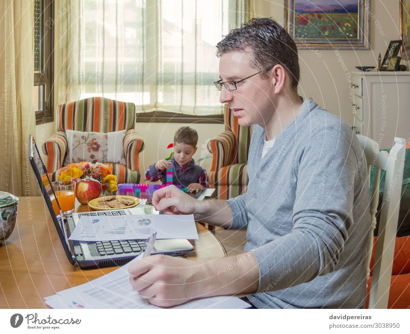 Father working in home office and son playing Lifestyle House (Residential Structure) Sofa Child Work and employment Office Business Telephone Computer Notebook